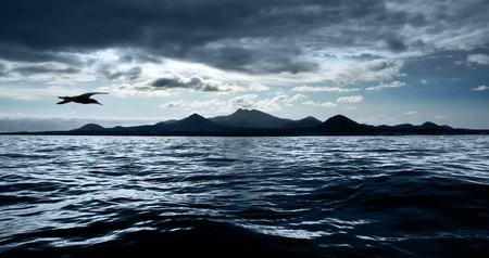stormy waters: A dark stormy sky over peaceful waters Stock Photo