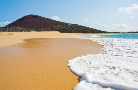 ascension: Water laps onto Long Beach, Ascension Island Stock Photo