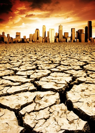 A city looks over a desolate cracked earth landscape Stock Photo - 4380958