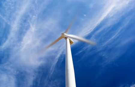 A large turbine spins in the wind photo