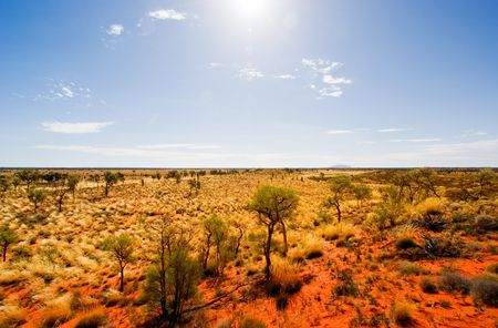 Central Australian Landscape with Uluru in the distance photo