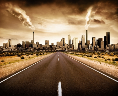 future city: Road leading to a polluted city Stock Photo