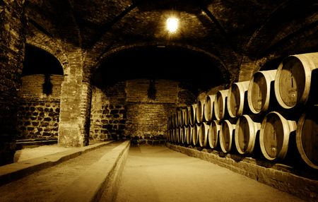 atmospheric: Old wine cellar with barrels Stock Photo