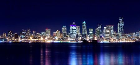 Seattle city lights up the night sky Stock Photo