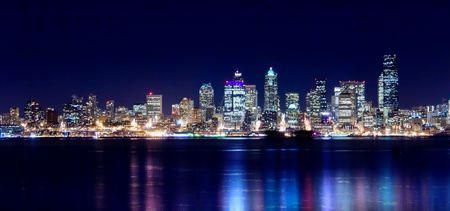 Seattle city lights up the night sky Stock Photo