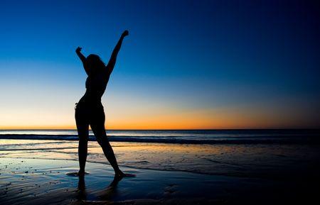 A girl enjoying the sunset Stock Photo - 6525515