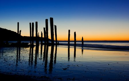 Old Jetty pilons at sunset Stock Photo - 6525496