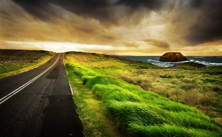 Road leads to a beautiful coastline photo