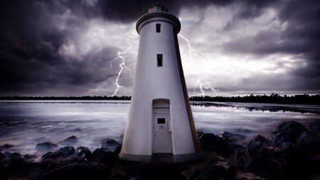 Lightning Strikes behind a lighthouse Stock Photo - 7689586