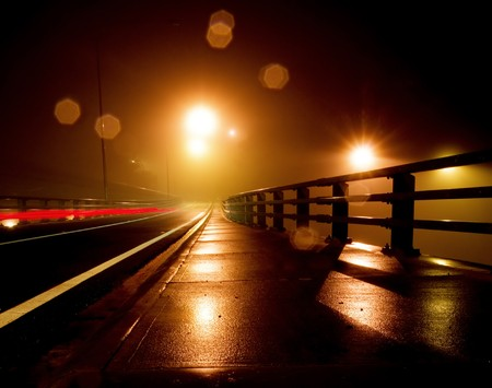 flyover: Wet and Rainy night on a bridge Stock Photo