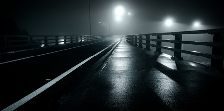 Deserted, misty road at night