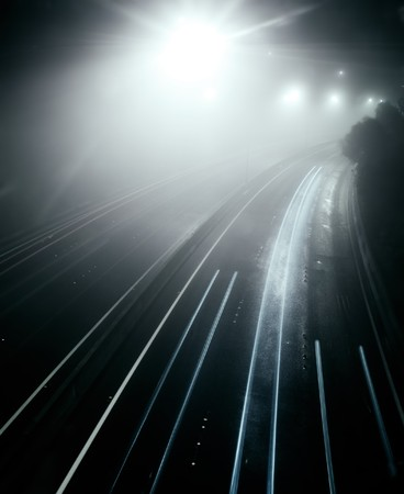 A misty freeway at night photo