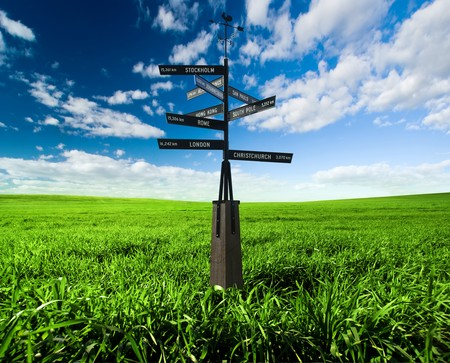 Sign post in a green field Stock Photo - 7689650