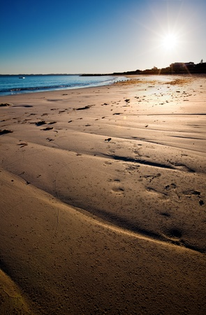 Sun makes the sand golden soon after sunrise Stock Photo - 9545063