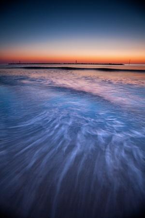 semaphore: Sunset at the beach Stock Photo