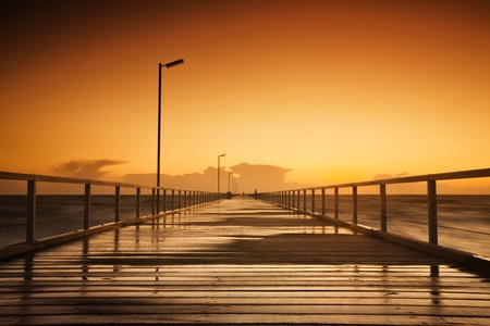 Beautiful sunset over a long jetty photo