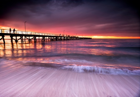 pier: Beautiful Sunset at Semaphore Beach, South Australia Stock Photo