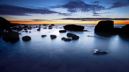 Sihouette of rocks and sunset on the coast
