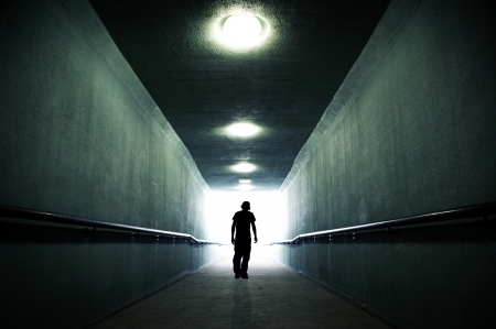 troubled teen: Youth walking into the light