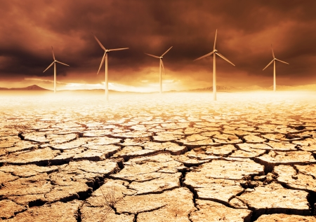 Wind Turbines on a cracked earth desert Stock Photo - 22300083