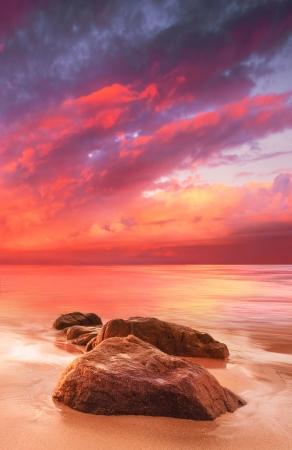 A beautiful tropical scene at sunset photo