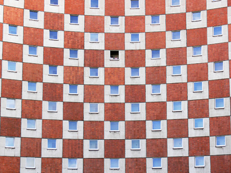 regularity: red, blue and white chessboard on the wall of the building with figures