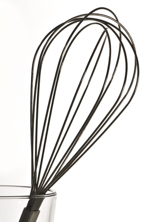 Stainless Steel Whisk over white background photo