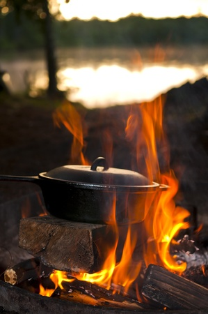 cast iron pan: Cast Iron Pan on the open fire by the lake