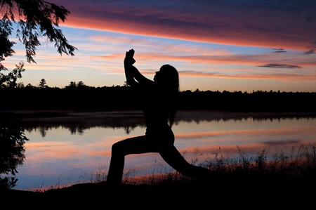 Girl Practicing Yoga by the lake at Sunset Stock Photo - 10128018