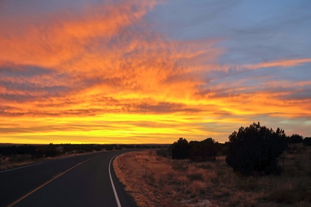 Road towards dramatic colorful sunset Stock Photo - 10466013