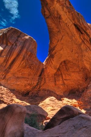 High Dynamic Range Photo Part of a  Double Arch against blue sky-  Moab Utah photo