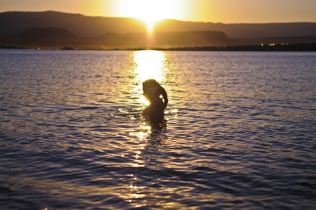 Relaxin bath in Lake Powell against golden sunset Stock Photo - 10467060