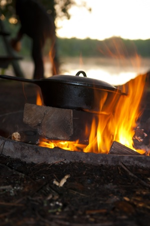 black appliances: Cast Iron Pan on the open fire by the lake