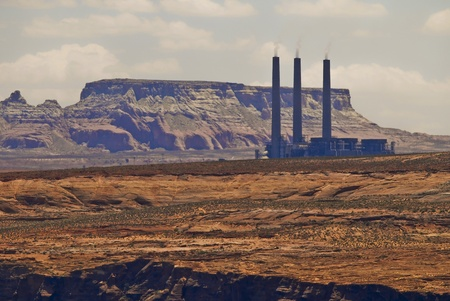 Workin plant with three chimneys in the middle of the desert in Arizona photo