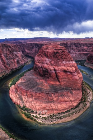 Stormy Dramatic Sky over Horseshoe Bend in Page Arizona photo