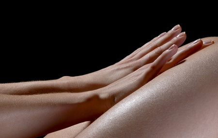 Soft Hands touching skin isolated over black background