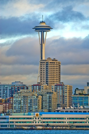 Vertical shot of a Seattle Space Neddle against dramatic cloudy sky  Stock Photo