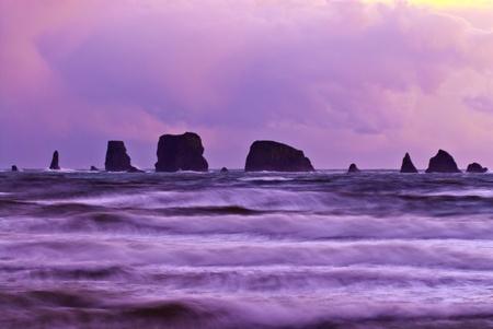 Big rocks and crushing waves against sun rising magenta sky - Third Beach forks washington Stock Photo - 12827110
