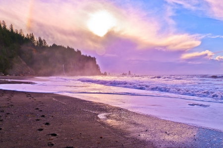 Crashing waves amazing sunset sky at La Push Beach in Olympic National Park