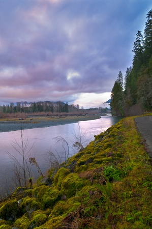 temperate: Quinault River and mountanis against cold dramatic sky Stock Photo