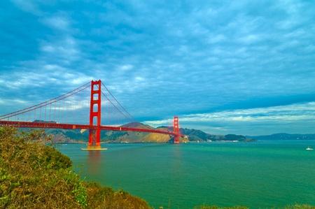 Famous Golden Gate Bridge against dramatic stormy sky photo