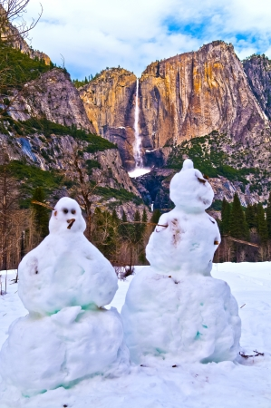 Two Snowmen against Upper Yosemite Falls - Yosemite National Park photo