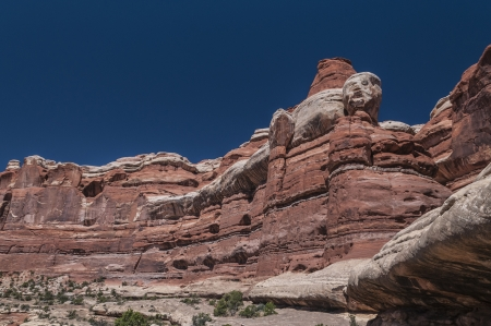 canyonland: Layers of colorful rock formations against blue sky