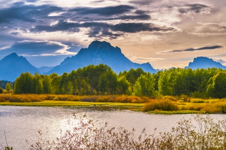 oxbow: Amazing Sunset over Grand Tetons taken from the Oxbow Bend Turnout Stock Photo