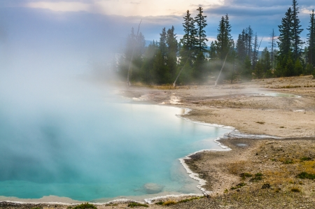 Black Pool Geyser at Sunrise with Dramatic Morning Sky photo