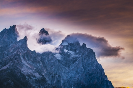 Dramatic Sunset Clouds over the mountain peaks - Grant Tetons photo