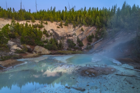 geysers: Beautiful Vibrant Geysers in Norris Basin Yellowstone after Sunset