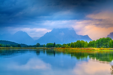 Gorgeous Sunrise, reflection in the water - Grand Tetons Oxbow Point photo