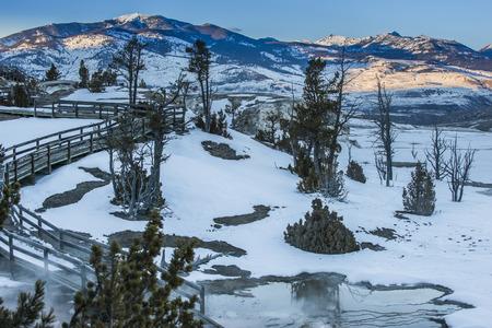 winter sunrise: Boardwalk near the geyser - winter in Yellowstone National Park