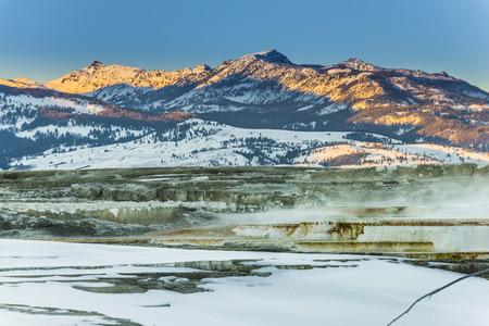winter sunrise: Beautiful Winter Geyser at Sunset - Yellowstone National Park